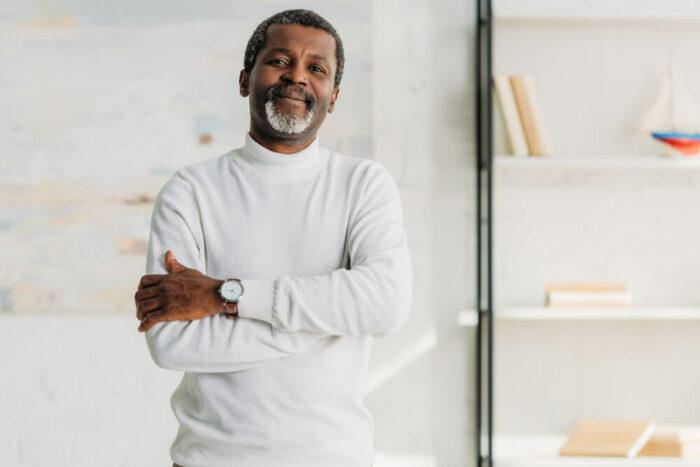Older man in white sweater